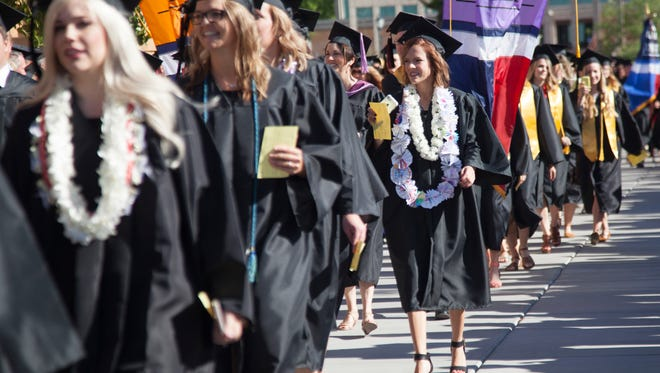 Students and faculty at Dixie State University commemorate the 2016 graduating class Friday, May 6, 2016.