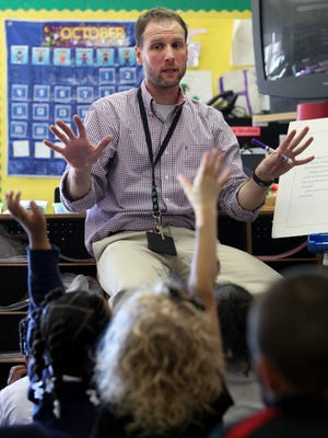 Joshua DeWar worked through a vocabulary lesson during his second-grade class at Engelhard Elementary School.  He is a finalist for Kentucky Teacher of the Year.