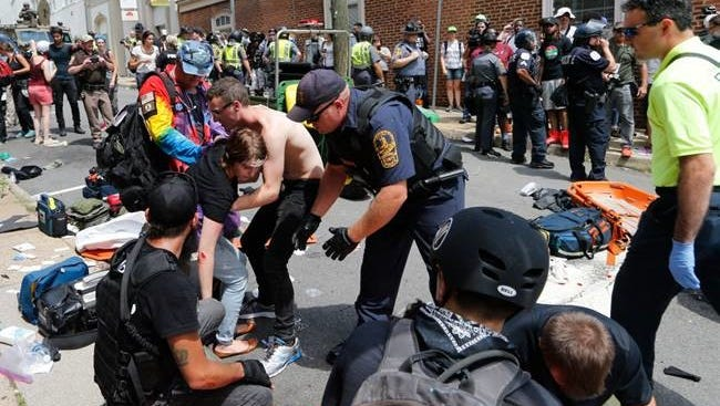 Rescue personnel help the injured after James Fields allegedly attacked protesters.