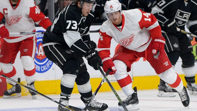 Red Wings center Gustav Nyquist (14) and Kings center Tyler Toffoli (73) battle for the puck in the first period of the Wings' 4-2 loss Monday at Los Angeles.