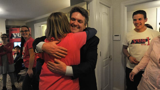 At the Tennessee Right To Life office Brian Harris hugs a co-worker after Yes on Ammendment one passed on Tuesday Nov. 4, 2014, in Nashville in Tenn.