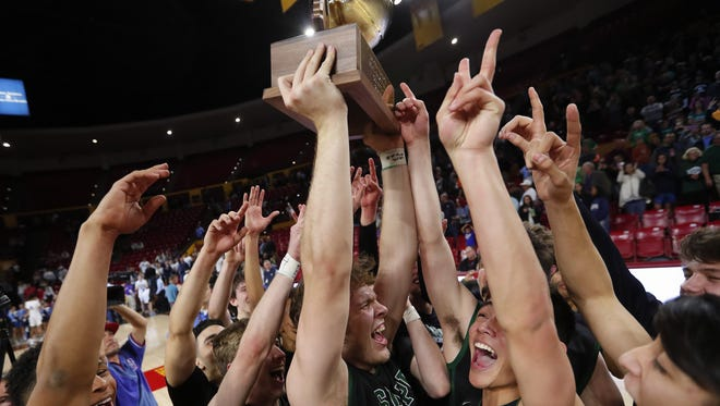 Sunnyslope players celebrate after beating Deer Valley to win the 5A Boys State Basketball Championship game at Wells Fargo Arena in Tempe, Ariz. February 27, 2018.
