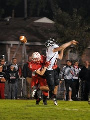 Port Clinton's Jordan Kleinhans hits Perkins' quarterback during a victory last season.