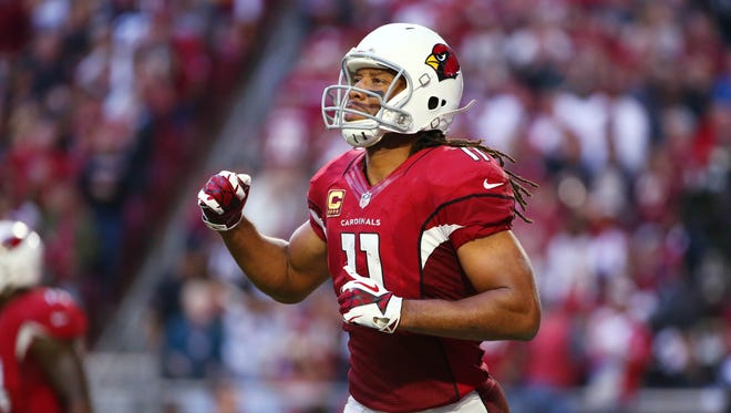Arizona Cardinals Larry Fitzgerald reacts with relief Michael Floyd after made a touchdown catch against Washington Redskins in the second half on Dec. 4, 2016 in Glendale, AZ.