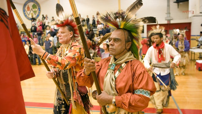 Chief Mark 'Quiet Hawk' Gould (center), a member of the Nanticoke Lenni-Lenape tribe, takes part in the grand entry dance at the start of the mini pow-wow that took place during the 3rd Annual Burlington County Native American Heritage Day held at the Kennedy Center in Willingboro.