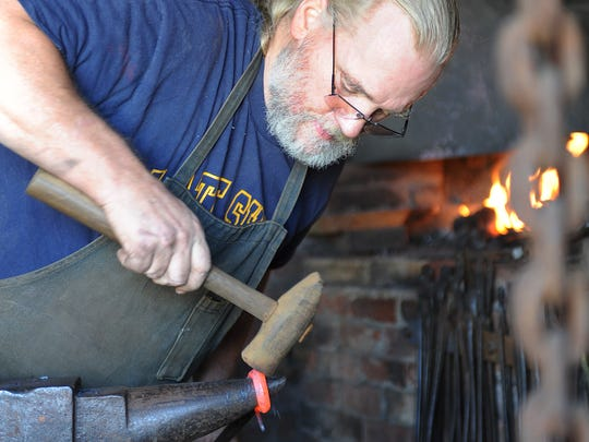 Lewes blacksmith John Ellsworth who runs  a shop on the corner of West 3rd Street and Chestnut St. in downtown Lewes practices the old art of blacksmithery.