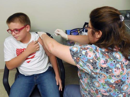 A seventh grader receives a Tdap vaccination.