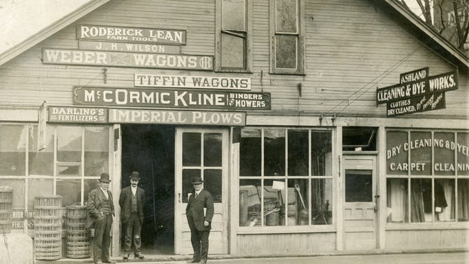 A photo of the first armory building on Center Street, taken sometime before it was destroyed in the 1913 flood, showing the businesses that were there at that time.