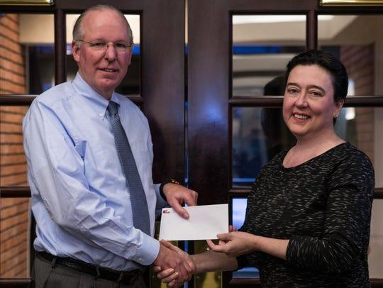 John H. Watt Jr. presents a check to Chenango Arts