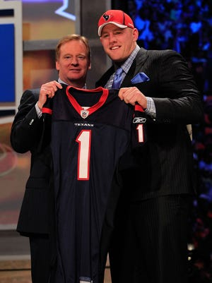 NFL commissioner Roger Goodell poses with J.J. Watt, the No. 11 overall pick by the Houston Texans, during the 2011 NFL Draft.