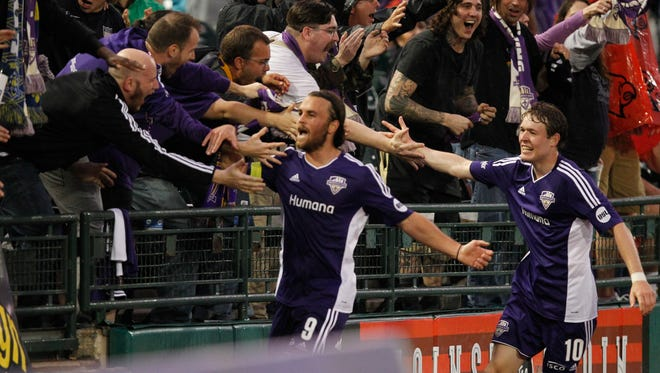 Louisville FC's Matt Fondy (9)celebrates his goal against  Toronto FC's defense during their game at Louisville Slugger Field in Louisville, Kentucky.         May 16, 2015