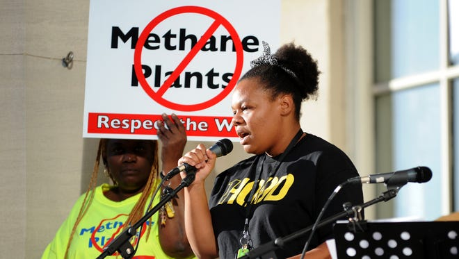 Chanelle Helm, MC for the rally, speaks and introduces the other speakers at the start of the rally at Louisville Metro Hall. Oct. 14, 2015