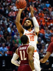 Clemson guard Gabe DeVoe (10) shoots as New Mexico