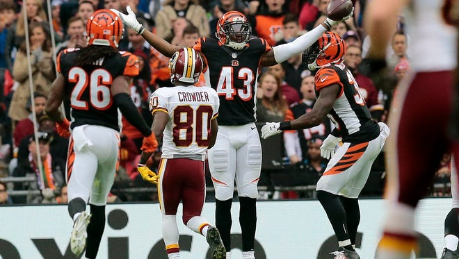 Cincinnati Bengals free safety George Iloka (43) celebrates an interception in the second quarter of the NFL Week 8 International Series game between Washington and the Cincinnati Bengals at Wembley Stadium in London on Sunday, Oct. 30, 2016. At the end of the first half, the Bengals trailed 10-7.