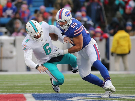 Dolphins quarterback Jay Cutler is knocked to the turf by Bills linebacker Matt Milano.