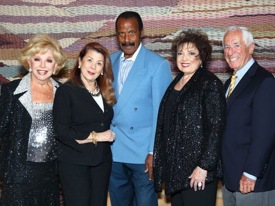 """(left to right): Honoree Ruta Lee, who was presented with The Desert Symphony's Amadeus Award, Linda Williamson, Fred """"the Hammer"""" Williamson, Nancy Tapick, president of The Desert Symphony, and Charles Polatsek."""