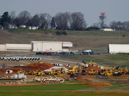 Construction near the runway expansion continues at McGhee Tyson Airport in Alcoa, Tennessee on Tuesday, February 21, 2017. McGhee Tyson has invested heavily in upgrading its concourse and customer experience including free wifi, big windows and electrical charging stations.