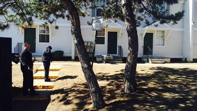 Investigators at the scene of the apartment complex on St. Aubin Street north of Jefferson Avenue, where two bodies were found in a freezer.