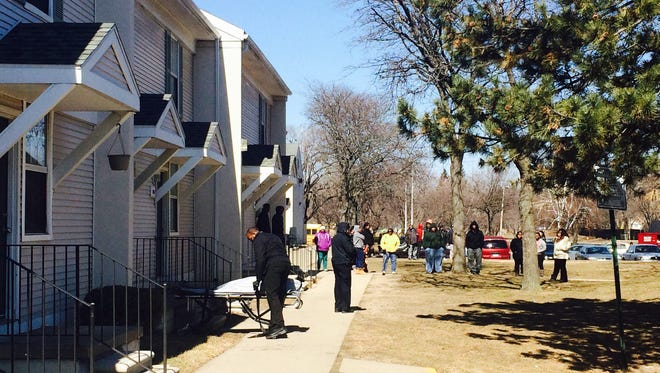 Investigators are the scene of the apartment complex on St. Aubin Street north of Jefferson Avenue, where two bodies were found in a freezer, Tuesday, March 24, 2015.