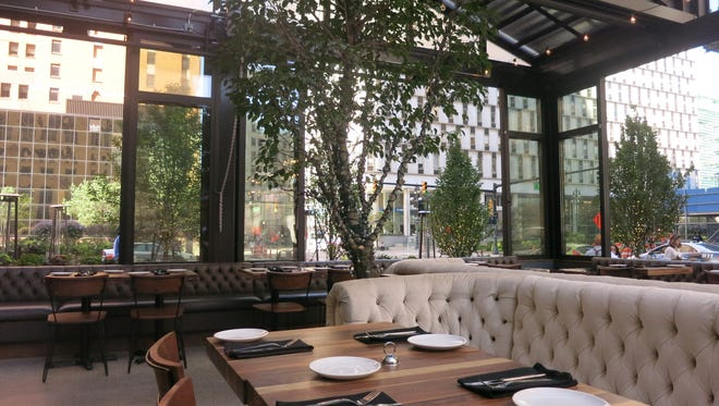 """The Townhouse Detroit main dining room -- set in an all-glass """"house"""" with moveable walls and roof beside One Detroit Center downtown -- stands ready for the lunch rush."""