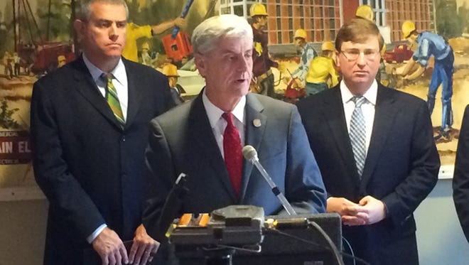 From left, House Speaker Philip Gunn, Gov. Phil Bryant and Lt. Gov. Tate Reeves talk about why they oppose Initiative 42 at an Oct. 22 press conference at Chain Electric. The officials say its passage would give too much power to chancery judges in funding public schools.