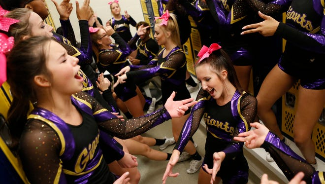 Waynesboro cheerleaders dance together in their locker room between rounds during the Conference 29 competition cheer championship at Fluvanna County High School on Saturday, Oct. 24, 2015.