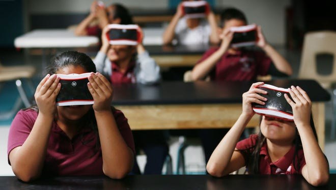 Ysleta Elementary School students, including Erika Chavez, foreground left, and Alicia Arzate, foreground right, watch undersea life in their Google Expeditions goggles at Camino Real Middle School. Ysleta Independent School District elementary and middle school students from various Lower Valley schools traveled to Camino Real to become acquainted with the Google Expeditions Pioneer Program. It is a virtual reality platform built for classroom use. The program offers more than 100 journeys to places around the world. Camino Real Principal Charles Garcia said Expeditions brings the world to the classroom for students who might never have the chance to see it otherwise.
