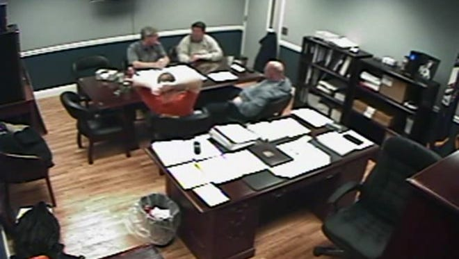 Grant Co. Judge-executive Steve Wood (back left), deputy judge-executive Steve Kimmich (back right), Jailer Chris Hankins (front right) and his brother and main assistant Jason Hankins (front left) discuss the jail's payroll budget in a video taken on Feb. 14.