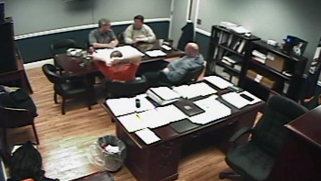 Grant Co. Judge-executive Steve Wood (back left), deputy judge-executive Steve Kimmich (back right), jailer Chris Hankins (front right) and his brother and main assistant Chris Hankins (front left) discuss the jail's payroll budget in a video recorded on Feb. 14.