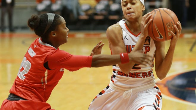 UTEP's Cameasha Turner, right, grabs a loose ball from New Mexico's Bryce Owens on Wednesday.