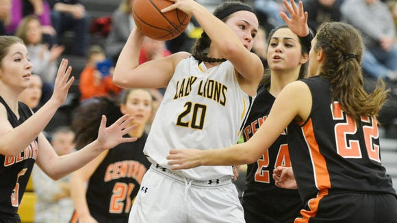 Red Lion's Amy Maciejewski (20) is swarmed by Central York defenders last season. Both the Lions and Panthers return a good portion of their starting lineups this year.