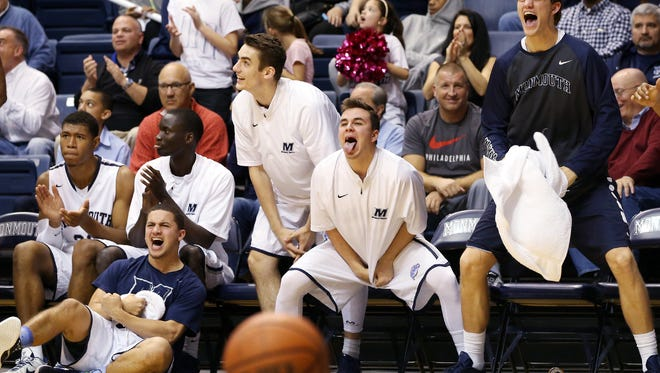 The Monmouth bench reacts to a second half play during the Hawks home-opener against Wagner, Sunday, December 13, 2015, in West Long Branch.