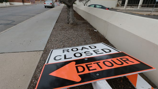 Detour signs were placed on the ground Monday next to the intersection of Arizona Avenue and North Stanton Street. The signs will be used to detour traffic when North Stanton is closed for the city's trolleycar construction project.