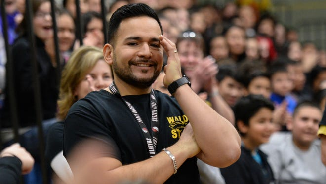 Did they really just call my name? Saleem-Keizer social studies teacher Ricardo Larios registers the fact that he's just won Oregon's 2015-16 Milken Educator Award and a check for $25,000 from the Milken Family Foundation.