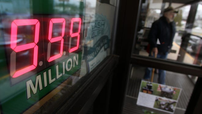 The Powerball sign at the Home Town Market in Neptune City tops out a $999 million, despite a current jackpot of $1.5 billion.