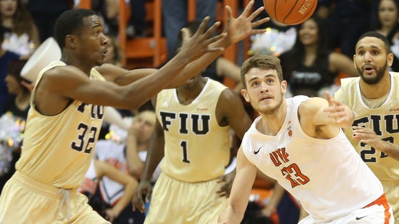 UTEP's Hooper Vint, right, and Florida International's Daviyon Draper scramble for a loose ball Saturday.
