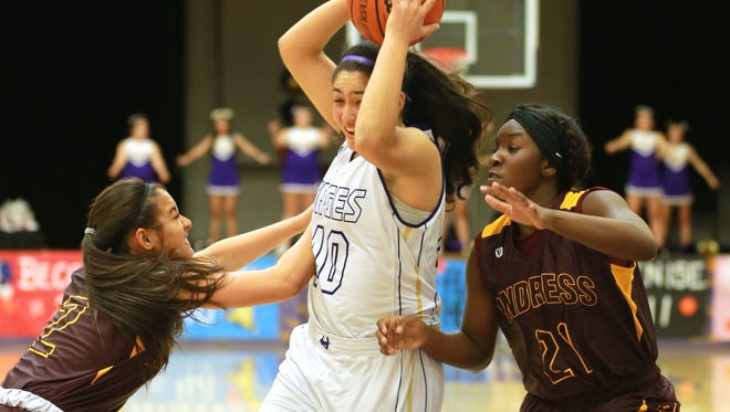 Burges' Mayra Garcia drives to the basket as Andress' Hannah Cooper, left, and Alexis Singleton defend Friday.