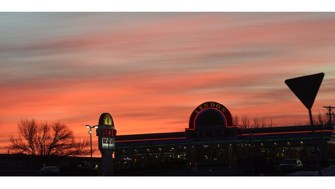 The sunrise can be seen behind the Lyndon Diner early Saturday, Feb. 6, 2016. According to AccuWeather.com, the day looks to be sunny with a high of 42 degrees.