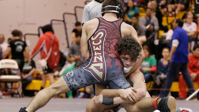 Arlington Martin's Jose Taylor defeated El Dorado's Christian Brown 14-3 in their 160-pound match Friday at the 2016 Class 6A Region I wrestling tournament at El Dorado High School.