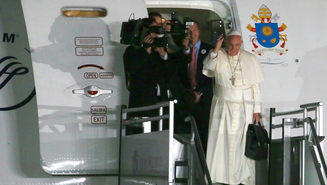 Pope Francis waves to the multitude bidding him farewell Wednesday at Abraham González International Airport in Juárez.