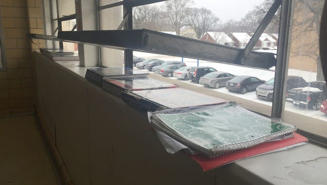 Teachers at the Cody Complex on Detroit's west side open the windows on Jan. 14, 2016, in winter temperatures and stack text books on the vents in the radiators to keep excessive heat from raising classroom temperatures above 90 degrees.
