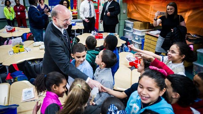 Gov. Tom Wolf shakes hands with students in teacher Maria Wood's second-grade class at Alexander D. Goode School in the York City School District. He visited several classrooms before making another push for increasing education funding in the state budget.