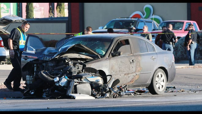 El Paso police investigate an accident in which a police officer's motorcycle was rear-ended by a car Thursday, leading to a fire.