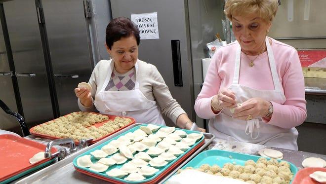 Maria Rokita, left, and Janina Stanton make sauerkraut pierogi at the American Polish Cultural Center on Dequindre Road in Troy.