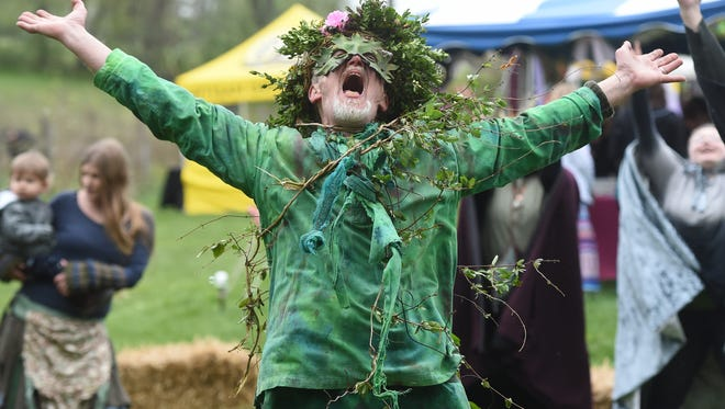 """Rob """"The Green Man"""" Wood leads the opening ceremonies of The May Day Fairie Festival at Spoutwood Farm in Glen Rock on Friday, April 29, 2016."""