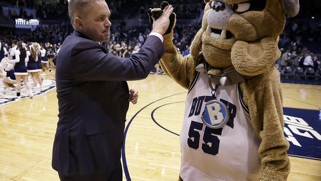 "Butler coach Chris Holtmann high-fives Butler's mascot ""Hink"" following their win over the Seton Hall, Mar 2, 2016 at Hinkle Fieldhouse."