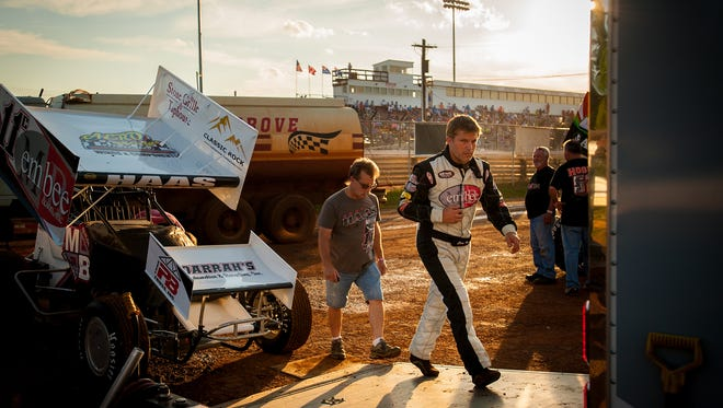 Driver Cory Haas walks back to his team's trailer after warm-up laps before racing in the World of Outlaws Tuneup Friday at Williams Grove Speedway.