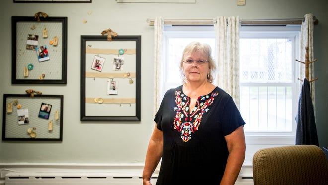 Jan Wilson, director of the York Rescue Mission's Single Women and Children's Shelter, poses for a portrait in the newly painted and remodeled lobby of the shelter. YTI Career Institute has an ongoing relationship with the shelter to provide repairs and maintenance.