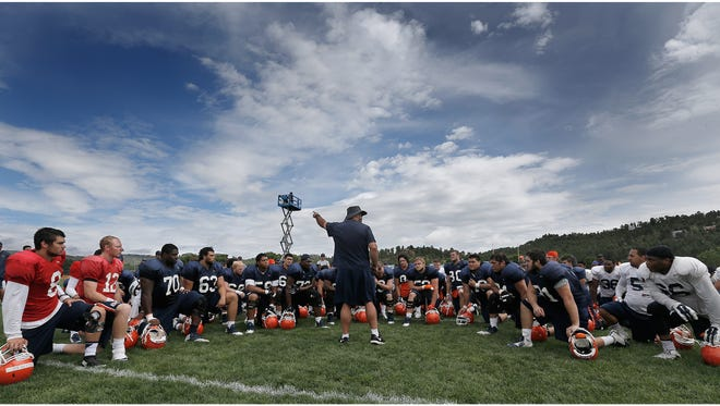 UTEP head coach Sean Kugler talks to his team following Wednesday's practice at Camp Ruidoso.