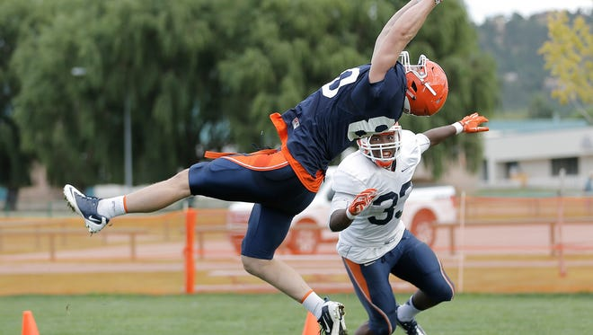 UTEP tight end Kent Taylor makes an impressive catch over linebacker Lawrence Montegut during practice Thursday at Camp Ruidoso.
